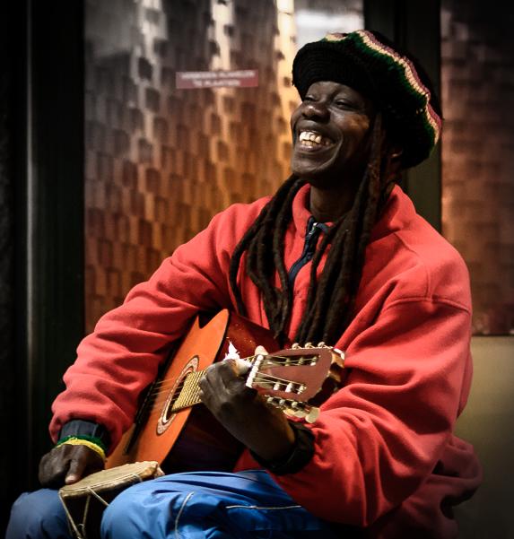 Rasta Man - Portrait of a rasta man playing reggae music on his guitar in Amsterdam, Holland 2016