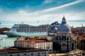 Now; and Then - a large cruiseship pulling in behind the cathedralNow; and Then - a large cruiseship pulling in behind the cathedral in Venice, Italy 2016
