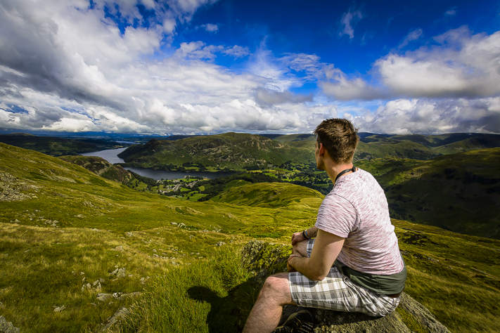 Beyond the Eye - myself  and a landsc ape view of the lakes at the summit of Helvellyn, Cumbria, England 2017