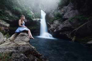 Mystic Waters - a girl overlooking a beautiful waterfall in Nelson, New Zealand 2018