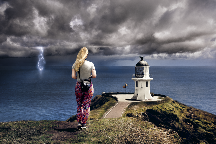 Edge of the World - My friend during a  storm over the edge of Cape Reinga, New Zealand 2018