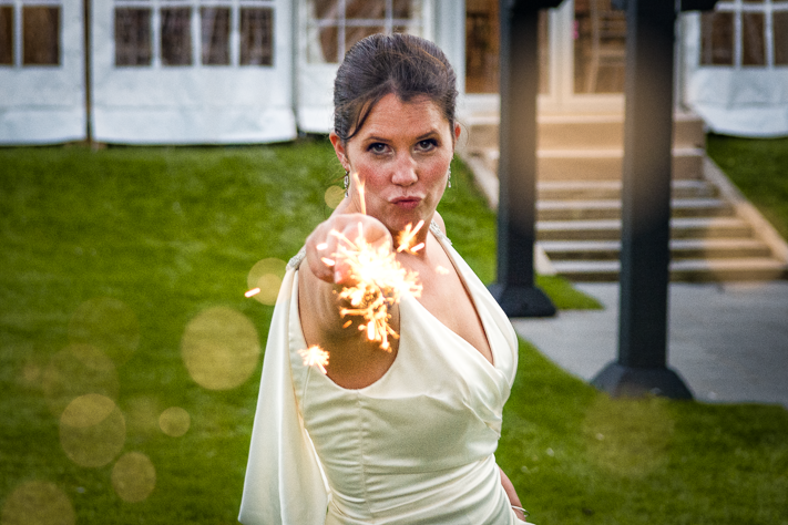 Sparks - a fun moment of the bride with a sparkler during her wedding photo shoot. Sanctum on the Green, Maidenhead, England 2017
