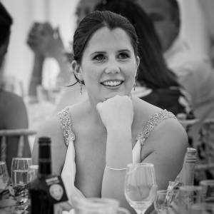 Joy - The bride during the best mans speech at her wedding. Sanctum on the Green, Maidenhead, England 2017