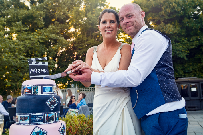 The Cutting - The happy couple cutting their wedding cake on their special day. Sanctum on the Green, Maidenhead, England 2017