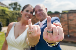 Just Married - A shot of the rings and the happy couple during their wedding day. Sanctum on the Green, Maidenhead, England 2017
