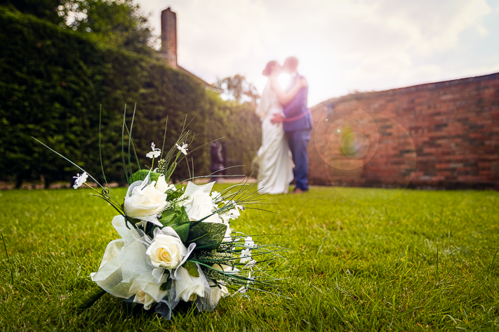 Love Blossoms - A shot of the bouquet and the newly weds on my first wedding shoot.  Sanctum on the Green, Maidenhead, England 2017