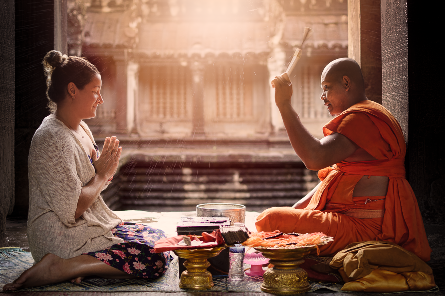 Blessings - Travel portrait of my friend recieving a blessing from a buddhist monk in Angkor Wat, Siem Reap, Cambodia 2017