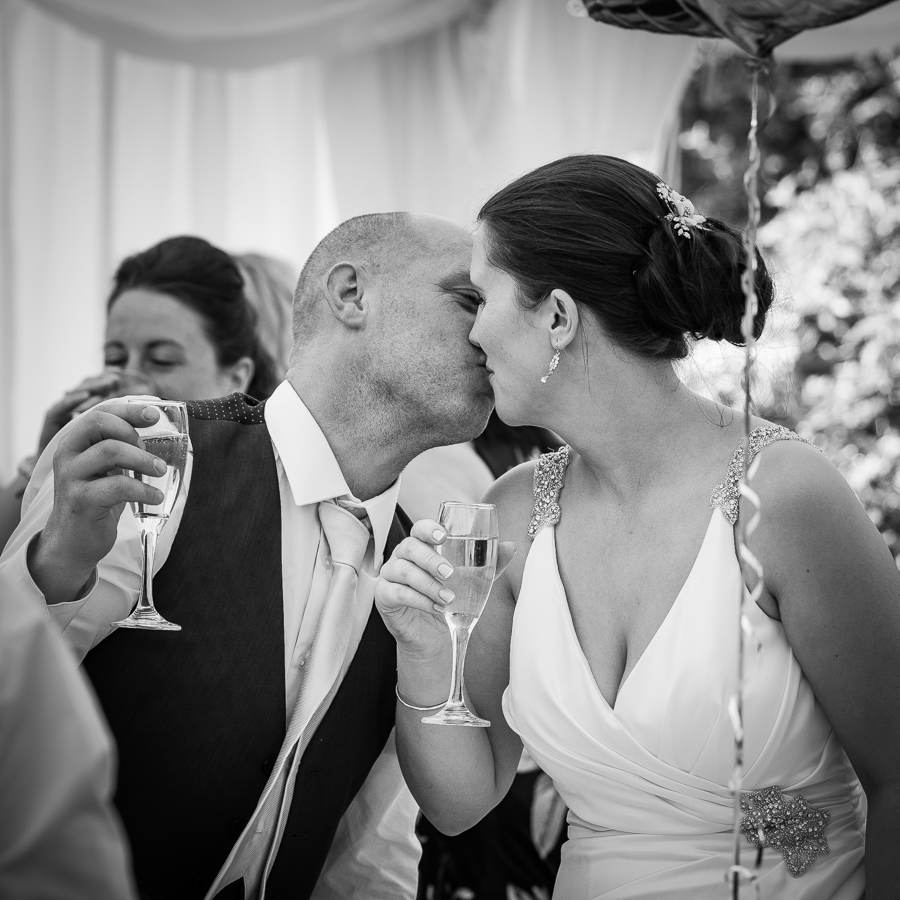 Passion - A secretly shared kiss between the happy couple on their wedding day. Sanctum on the Green, Maidenhead, England 2017
